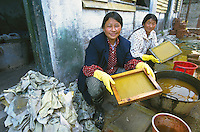 Tibetans making reccyclled paper through the Green Recycling Center.