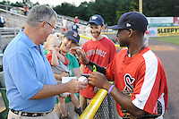 Outfielder Jackie Bradley Jr. (16) of the Salem Red Sox high-fives a toddler before a game against the Potomac Nationals on June 8, 2012, at Pfitzner Stadium in Woodbridge, Virginia. Potomac won the second game of a doubleheader, 4-2. Bradley is the No. 10 Boston prospect, according to Baseball America. (Tom Priddy/Four Seam Images)