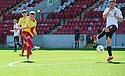 Albion's Chris Cadden scores their first goal.