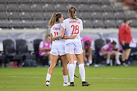 HOUSTON, TX - APRIL 09: Sarah Gorden #11 of the Chicago Red Stars hugs teammate Kayla Sharples #28 after a game between Chicago Red Stars and Houston Dash at BBVA Stadium on April 09, 2021 in Houston, Texas.