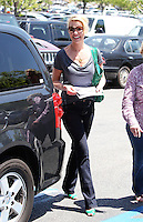 Katherine Heigl was shopping for fabrics with her mom Nancy once again. Katherine looked casual in a gray tee and blue denim jeans with a Valentino Nuage Bow emerald green python bag. Los Angeles, California on 09.05.2012..Credit: Correa/face to face.. /MediaPunch Inc. ***FOR USA ONLY***