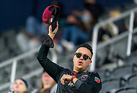WASHINGTON, DC - APRIL 17: A fan cheers before a game between New York City FC and D.C. United at Audi Field on April 17, 2021 in Washington, DC.