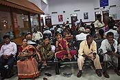 Family members of the patients seen waiting in the waiting lounge of the Narayana Hrudayalaya in Bangalore, Karnataka, India. Photo: Sanjit Das/Panos