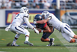 Nevada defenders Asauni Rufus (2) Jordan Dobrich (49) tackle Arizona quarterback Anu Solomon in an NCAA college football game in Reno, Nev., on Saturday, Sept. 12, 2015.(AP Photo/Cathleen Allison)