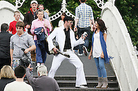"""NO REPRO FEE. 11/8/2010. Elvis Presley Story. Irelands foremost Elvis performer Kevin Doyle is pictured in his Elvis costume rehearsing on the Ha Penny Bridge Dublin with Mimi in preparation for his show """" Kevin Doyle Sings the Elvis Presley Story"""" this Sunday the 15th of August at the Olympia Theatre. Tickets are from 25.50 including booking fee on sale now. Picture James Horan/Collins Photosemail - info@collinsphotos.com"""