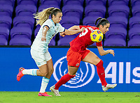 ORLANDO, FL - FEBRUARY 21: Adriana Sachs #21 of Argentina defends Evelyne Viens #9 of Canada during a game between Canada and Argentina at Exploria Stadium on February 21, 2021 in Orlando, Florida.