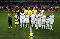 Wednesday, 01 January 2014<br /> Pictured: Vincent Kompany (L) and Ashley Williams (R) with mascots and referees.<br /> Re: Barclay's Premier League, Swansea City FC v Manchester City at the Liberty Stadium, south Wales.