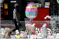 NEW YORK - NEW YORK - APRIL 03: A woman is reflected on a window displaying Easter decorations on April 03, 2021 in New York. NYC and most of the United States are planning a year later after pandemic, the celebration of the of Easter which may return with some of normalcy under New York state guidelines. (Photo by John Smith/VIEWpress)