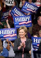 Sen. Hillary Clinton pauses while being greeted by supporters upon her arrival for her first Presidential campaign stop in Iowa  Saturday, January 28, 2006 in Des Moines.  Clinton held an open conversation with Iowans at East High School's  Community Center.