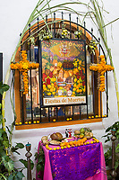 Oaxaca, Mexico, North America.  Day of the Dead Celebrations.  Altar in Memory of the Dead at Entrance to a Shopping Area.  Decorations.  Cross, Flowers, Marigolds.