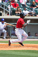 Tim Anderson (7) of the Birmingham Barons follows through on his swing against the Tennessee Smokies at Regions Field on May 4, 2015 in Birmingham, Alabama.  The Barons defeated the Smokies 4-3 in 13 innings. (Brian Westerholt/Four Seam Images)
