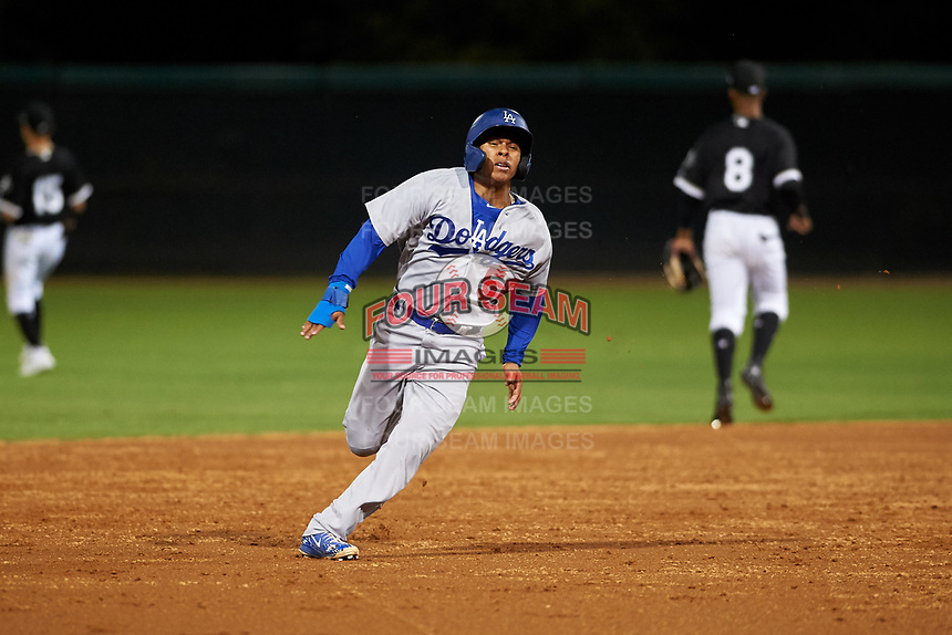 AZL Dodgers Lasorda Jorbit Vivas (56) runs to third base during an Arizona League game against the AZL White Sox at Camelback Ranch on June 18, 2019 in Glendale, Arizona. AZL Dodgers Lasorda defeated AZL White Sox 7-3. (Zachary Lucy/Four Seam Images)