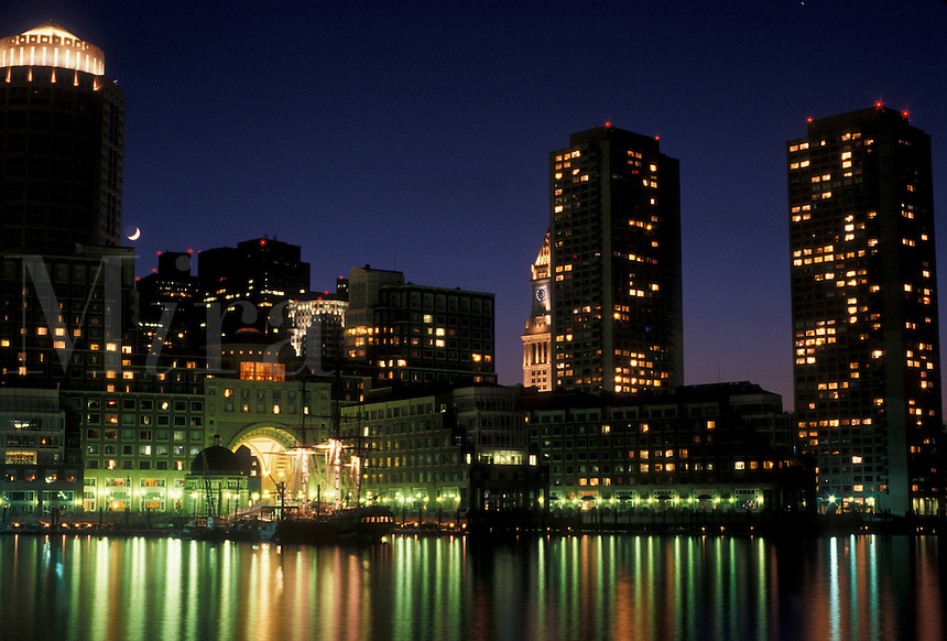 AJ4437, Boston, skyline, downtown, Massachusetts, The lights of the downtown skyline of Boston reflects in the calm waters of the Boston Harbor at night in the state of Massachusetts.