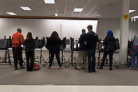 Voters use electronic voting machines at a Columbus, Ohio, early voting center on the first day of early voting in the state..