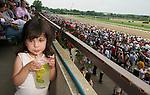 6 June 10: Lana Stearn, 3, of Manhattan enjoys some lemonade at Belmont Park in Elmont, New York on Belmont Stakes Day.
