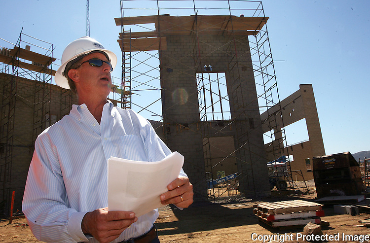 Principal of the school, Keith Nuthall, explains aspects of the school as work continues in 2012 at Del Lago Academy in Escondido, California. Behind him is a structure that will be the multi-purpose building at the school.  photo for the North County Times