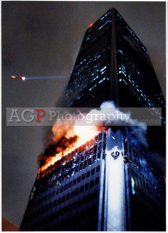 A helicopter flys near the First Interstate Bank building in Los Angeles as the building burns Thursday May 4, 1988. One person died and 30 were injured in the worst high-rise fire in Los Angeles history. This picture ran on the front page of the New York Times on May 6, 1988. (Alan Greth)