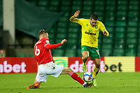 2nd January 2021; Carrow Road, Norwich, Norfolk, England, English Football League Championship Football, Norwich versus Barnsley; Mads Juel Andersen of Barnsley challenges Emi Buendia of Norwich City