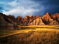 Grass meadow and colorful rocks. Badlands National Park, South Dakota.