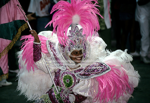 Rio de Janeiro, Brazil. Mangueira Samba School standard bearer in pink and white feathers and sequins; Carnival.