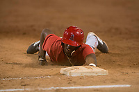 AZL Angels right fielder Trent Deveaux (17) slides into first base on a pick-off attempt during an Arizona League game against the AZL Giants Black at the San Francisco Giants Training Complex on July 1, 2018 in Scottsdale, Arizona. The AZL Giants Black defeated the AZL Angels by a score of 4-2. (Zachary Lucy/Four Seam Images)