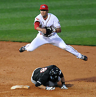 April 5, 2008: Kristopher Negron (17) of the Greenville Drive tags out Greg Paiml (8) of the Kannapolis Intimidators and makes the turn for a double play in a game at Fluor Field at the West End in Greenville, S.C. Photo by:  Tom Priddy/Four Seam Images
