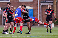 Josh WALTERS (13) of London Broncos comes into contact with Kyle KESIK (9) of Keighley Cougars during the Betfred Challenge Cup Round One match between London Broncos and Keighley Cougars at The Rock, Rosslyn Park, London, England on 20 March 2021. Photo by David Horn.
