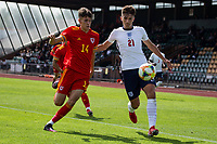 3rd September 2021; Newport, Wales:  Zak Emmerson of England and Ben Hammond of Wales battle for the ball during the U18 International Friendly  match between Wales and England at Newport Stadium in Newport, Wales.