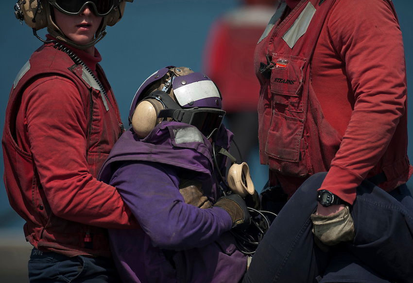 120331-N-DR144-597 ARABIAN SEA (March 31, 2012) Sailors assigned to the Air Department's Crash and Salvage Division simulate rescuing a Sailor assigned to V-4 Division during flight deck firefighting drills aboard the Nimitz-class aircraft carrier USS Carl Vinson (CVN 70). Carl Vinson and Carrier Air Wing (CVW) 17 are deployed to the U.S. 5th Fleet area of responsibility.  (U.S. Navy photo by Mass Communication Specialist 2nd Class James R. Evans/Released)