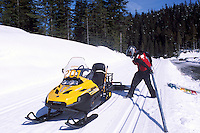 Ski Patrol on Skidoo servicing Groomed Cross Country Ski Tracks at Whistler Olympic Park - Site of Vancouver 2010 Winter Games, Whistler Resort, British Columbia, Canada