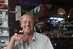 A foreigner sits in a bar early in the morning on Bui Vien Street in Ho Chi Minh City, Vietnam. Aug. 27, 2011.