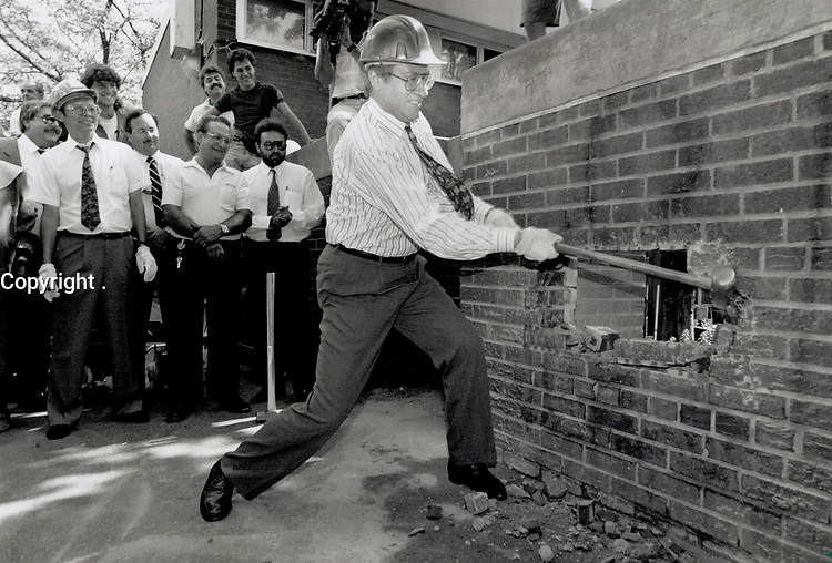 1990 FILE PHOTO - ARCHIVES -<br /> <br /> Anti-drug blow: Toronto Mayor Art Eggleton Swings a sledgehammer yesterday to help start demolishing walls at Alexandra Park that residents say conceal drug deals in the neighborhood.<br /> <br /> 1990<br /> <br /> PHOTO :  Erin Comb - Toronto Star Archives - AQP