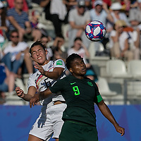 GRENOBLE, FRANCE - JUNE 22: Lena Oberdorf #6 of the German National Team, Desire Oparanozie #9 of the Nigerian National Team battle for head ball during a game between Panama and Guyana at Stade des Alpes on June 22, 2019 in Grenoble, France.