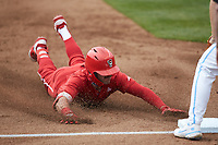 Austin Murr (12) of the North Carolina State Wolfpack slides head first into third base after hitting a triple against the North Carolina Tar Heels at Boshamer Stadium on March 27, 2021 in Chapel Hill, North Carolina. (Brian Westerholt/Four Seam Images)