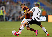 Calcio, Serie A: Roma vs Juventus. Roma, stadio Olimpico, 30 agosto 2015.<br /> Roma's Juan Iturbe, left, is challenged by Juventus' Giorgio Chiellini during the Italian Serie A football match between Roma and Juventus at Rome's Olympic stadium, 30 August 2015.<br /> UPDATE IMAGES PRESS/Riccardo De Luca
