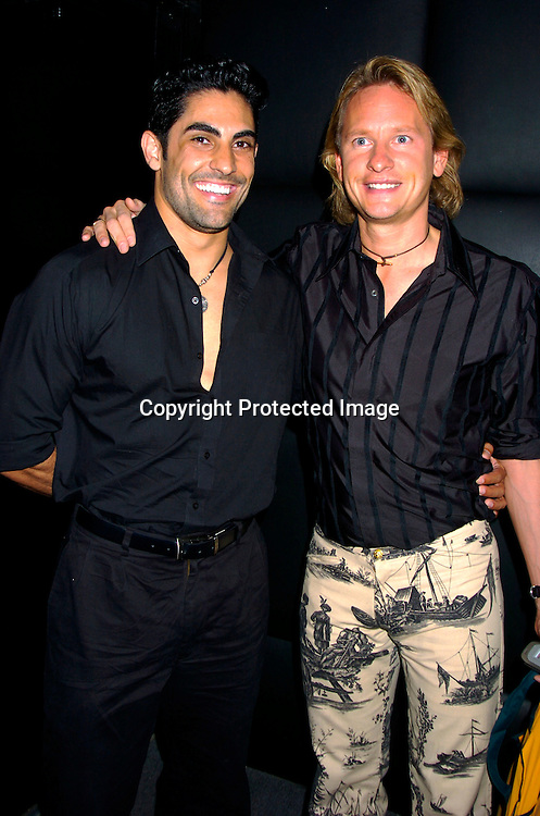 """Carson Kressley and boyfriend Marcos DeSousa ..at Animal Fair's fifth Annual """" Paws for Style"""" fashion show to celebrate the 100th year anniversary of the Humane society of New York. The event was on May 24, 2004 at ..Club Black...Photo by Robin Platzer, Twin Images"""