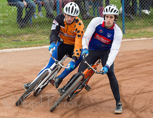 19 APR 2015 - IPSWICH, GBR - Josh Brooke (right) of Ipswich Eagles and Damian Zareba (left) of Sheffield Stars battle for position during the two teams Elite League cycle speedway fixture at Whitton Sports and Community Centre in Ipswich, Suffolk, Great Britain (PHOTO COPYRIGHT © 2015 NIGEL FARROW, ALL RIGHTS RESERVED)