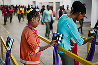 ETHIOPIA , Southern Nations, Hawassa or Awasa, Hawassa Industrial Park, chinese-built for the ethiopian government to attract foreign investors with low rent and tax free to establish a textile industry and create thousands of new jobs, taiwanese company Everest Textile Co. Ltd. , women check out after work by fingerprint with digital time recording / AETHIOPIEN, Hawassa, Industriepark, gebaut durch chinesische Firmen fuer die ethiopische Regierung um die Hallen fuer Textilbetriebe von Investoren zu vermieten, taiwanesische Firma Everest Textile Co. Ltd., digitale Arbeitszeiterfassung per Fingerabdruck