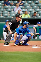 Oklahoma City Dodgers catcher Kyle Farmer (23) awaits the pitch during a game against the Colorado Springs Sky Sox on June 2, 2017 at Chickasaw Bricktown Ballpark in Oklahoma City, Oklahoma.  Colorado Springs defeated Oklahoma City 1-0 in ten innings.  (Mike Janes/Four Seam Images)