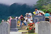 Families gathered around tombstones for Ching Ming, an annual Chinese ceremony honoring the ancestors, Manoa Chinese Cemetery, Manoa Valley, Honolulu