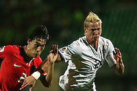 The United States' Brek Shea (20) fights for the ball against South Korea's Jae Suk Oh (2)  during the FIFA Under 20 World Cup Group C match between the United States and South Korea at the Mubarak Stadium on October 02, 2009 in Suez, Egypt. The US team lost 3-0.