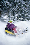 Father & daugther tubing in fresh snow, Rocky Mtns, CO