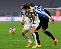 Calcio, Serie A: Juventus - Atalanta, Turin, Allianz Stadium, December 16, 2020.<br /> Juventus' Federico Chiesa (l) in action with Atalanta's Hans Hateboer (r) during the Italian Serie A football match between Juventus and Atalanta at the Allianz stadium in Turin,  December 16, 2020.<br /> UPDATE IMAGES PRESS/Isabella Bonotto