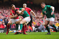 Pictured: Jacob Stockdale of Ireland is tackled by George North of Wales during the Guinness six nations match between Wales and Ireland at the Principality Stadium, Cardiff, Wales, UK.<br /> Saturday 16 March 2019