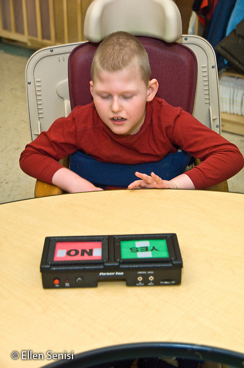 MR / Albany, NY.Langan School at Center for Disability Services .Ungraded private school which serves individuals with multiple disabilities. Student using an alternative and augmentative communication device during speech and language development lesson. This device allows students to choose yes or no in response to a question asked.Boy: 9, cerebral palsy, non verbal with expressive and receptive language delays.MR: Law4.© Ellen B. Senisi