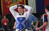 05 MAY 2012 - MANCHESTER, GBR - Aaron Cook (GBR) of Great Britain celebrates winning the men's 2012 European Taekwondo Championships -80kg category final at Sportcity in Manchester, Great Britain against Ramin Azizov of Azerbaijan when the referee penalised Azizov for stepping out of the field of play in the final second of the last round to give Cook the title .(PHOTO (C) 2012 NIGEL FARROW)