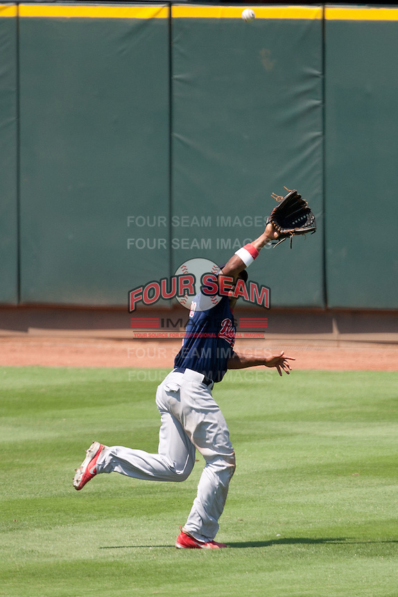 Memphis Redbirds outfielder Adron Chambers #4 makes a running catch during the Pacific Coast League baseball game against the Round Rock Express on May 6, 2012 at The Dell Diamond in Round Rock, Texas. The Express defeated the Redbirds 5-1. (Andrew Woolley/Four Seam Images)