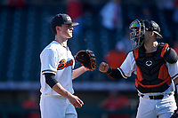 Oregon State Beavers relief pitcher Nathan Burns (24) talks to catcher Troy Claunch (17) between innings of an NCAA game against the New Mexico Lobos at Surprise Stadium on February 14, 2020 in Surprise, Arizona. (Zachary Lucy / Four Seam Images)