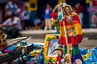 A colorful statue of Santa Muerte (Holy Death) is seen placed on the street during a religious pilgrimage in Tepito, Mexico City, Mexico, 1 April 2018. The religious cult of Santa Muerte is a fusion of Aztec death worship rituals and Catholic beliefs. Born in lower-class neighborhoods of Mexico City, it has always been closely associated with crime. In the past decades, original Santa Muerte followers, such as prostitutes, pickpockets and street drug traffickers, have merged with thousands of ordinary Mexican Catholics. The Holy Death veneration, offering a spiritual way out of hardship in modern society, rapidly expanded. Although the Catholic Church still considers Santa Muerte followers the devil worshippers, on the first day of every month, crowds of Santa Muerte believers fill the streets of Tepito. Holding statues of Holy Death clothed in a long robe, they pray for healing, protection, money or any other favor in life.