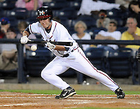 9 April 2008: Matt Young (6) of the Mississippi Braves bunts  during the Braves' home opener against the Mobile BayBears at Trustmark Park in Pearl, Miss. Photo by:  Tom Priddy/Four Seam Images